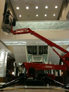High level painting using a cherry picker